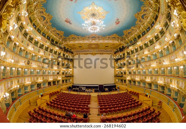 """VENICE - APRIL 7, 2014: Interior of La Fenice Theatre. Teatro La Fenice, """"The Phoenix"""", is an opera house, one of the most famous and renowned landmarks in the history of Italian theatre."""