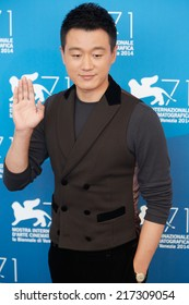 VENICE - AUGUST 28: Tong Dawei at 'Dearest' photocall during the 71st Venice Film Festival on August 28, 2014 in Venice.