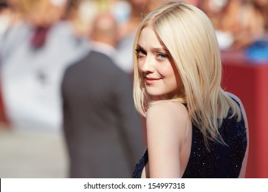 VENICE - AUGUST 31:Dakota Fanning at 'Night Moves' premiere at the 70th Venice Film Festival on August 31, 2013 in Venice.