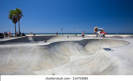 VENICE BEACH, CA - AUG 14:  Skateboarder at landmark skatepark at Venice Beach, CA seen on Aug. 14, 2012. This 16,000 sq. foot skatepark is one of the only in the world located on a beach.