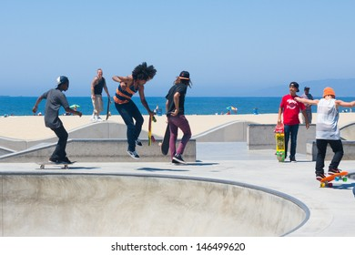 VENICE BEACH, CA - AUG 14:  Skateboarders at Venice Beach in LA on Aug 14, 2012. Venice is one of LA's most popular beaches attracting surfers, skateboards, bohemians, musicians and tourists.