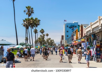 VENICE BEACH, CALIFORNIA - JULY 17, 2007: The crowded boardwalk of Venice Beach in the city of Los Angeles during a sunny and bright day of summer.