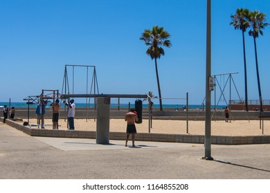 VENICE BEACH, CALIFORNIA - JULY 19, 2007: People practising boxing workouts with punching balls in Venice Beach.