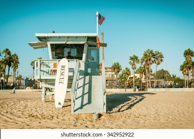 VENICE BEACH, CALIFORNIA USA - SEPTEMBER 29: Lifeguard station with a surf leaning on it on 29 September 2015