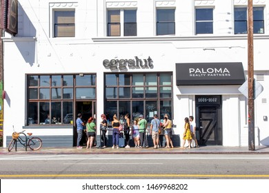 Venice Beach, California/United States - 06/29/19: People wait in line outside the restaurant known as Eggslut