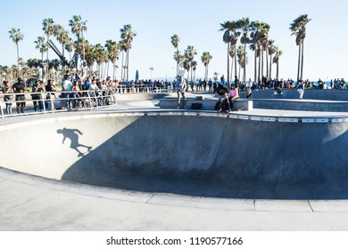 Venice Beach, Los Angeles, California - February 25 2018: Shadow of skater in halfpipe at Venice Beach skatepark at a sunny day