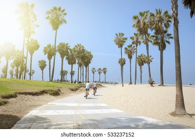 VENICE BEACH, LOS ANGELES, CALIFORNIA - MAY 29 2015: People enjoying a sunny day on the beach of Venice, California, on May 29, 2015. Summer time activities.