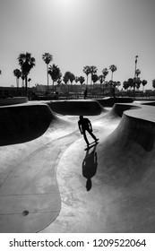 venice beach skate park with skater silhouette, black and white photo