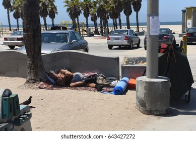 VENICE BEACH, USA - MAY 18, 2017: Homeless people on world famous Venice Beach Boardwalk one of the most popular attraction of California, on May 18, 2017 Venice Beach, CA