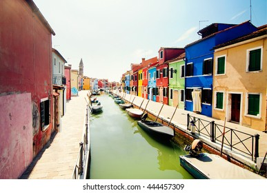 Venice, Burano island, colored houses and the boats.Italy.