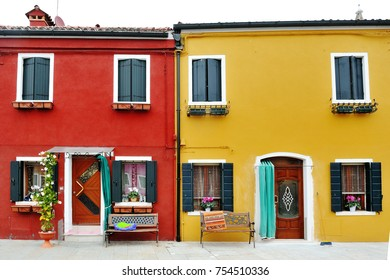 Venice, Burano island, Italy - characteristic red and yellow building
