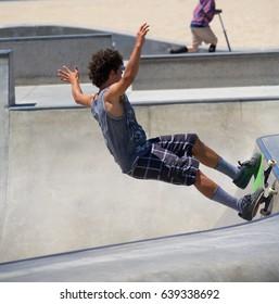 VENICE, CALIFORNIA - April 20, 2017: Skateboarder Brian Waters doing tricks at the Venice Skate Park in Venice Beach, California.