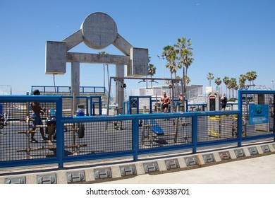 VENICE, CALIFORNIA - April 20, 2017: Unknown bodybuilders working out at Muscle Beach in Venice Beach, California.