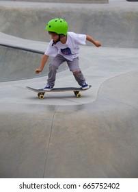 VENICE, CALIFORNIA - April 20, 2017: Unidentified young boy skateboarding at at Venice Skate Park in Venice Beach California.