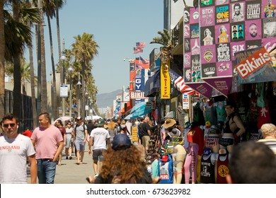 VENICE, CALIFORNIA - April 20, 2017: People walking on the boardwalk of Venice Beach in Los Angeles California