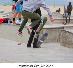 VENICE, CALIFORNIA - May 24, 2017: Unidentified doing tricks at Venice Skate Park in Venice Beach California.