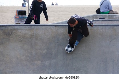 VENICE, CALIFORNIA - May 24, 2017: Unidentified male riding skateboard in bowl at Venice Skate Park in Venice Beach California.