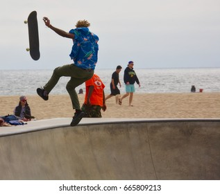 VENICE, CALIFORNIA - May 24, 2017: Unidentified skateboarder falling after attempting a trick at Venice Skate Park in Venice Beach California.