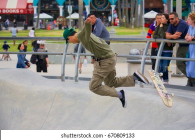 VENICE, CALIFORNIA - May 24, 2017: Unidentified man falling after attempting trick while skateboarding at at Venice Skate Park in Venice Beach California.