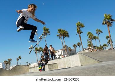 VENICE, CALIFORNIA - SEPTEMBER 11, 2016: A skateboarder performs a 360 flip at the Venice skatepark.