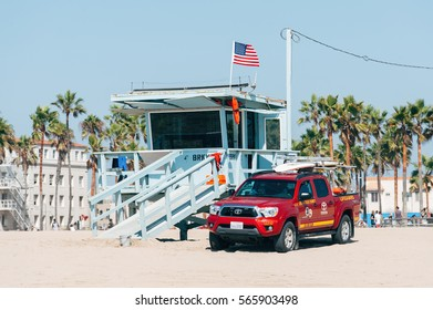 VENICE, CALIFORNIA USA - NOVEMBER 5, 2016: Life guard tower on a Venice beach in Los Angeles California USA. Sunbathing people on the beach at sunny day.