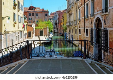 Venice, canal with boats and historic buildings