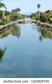 Venice Canal Historic District, CA - May 27, 2018: A bridge spanning the Venice Canal Historic District. It is a district in the Venice section of Los Angeles, California.
