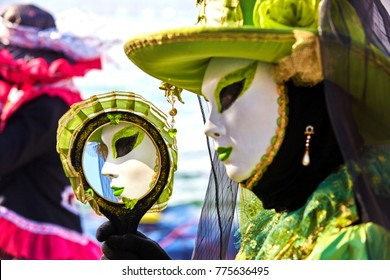 Venice carnival 2017. Venetian Carnival Costume. Venetian Carnival Mask. Venice, Italy. Reflection in the mirror. Venetian Green Carnival Costume