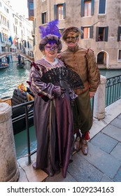 Venice Carnival 2018: Model wearing traditional Venetian mask and costume, Venice, Italy