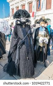 Venice Carnival (Italian: Carnevale di Venezia) 2018. Traditional Venetian masks in Piazza San Marco during the Volo dell' Angelo event, Venice, Italy
