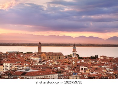 Venice city with Mestre and Dolomiti mountains in background at sunset.