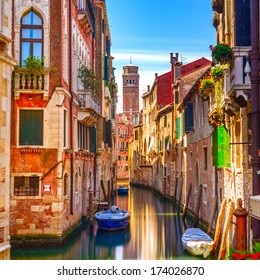 Venice cityscape, narrow water canal, campanile church on background and traditional buildings. Italy, Europe.