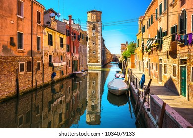Venice cityscape, water canal, tower, and traditional buildings. Italy, Europe.