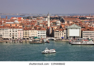 Venice city-view from rooftop and falling bell tower of the church of San Giorgio dei Grec