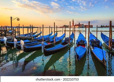 Venice with famous gondolas at sunrise, Italy