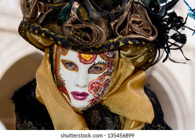 VENICE - FEB 9: An unidentified masked person in costume in St. Mark's Square during the Carnival of Venice on February 9, 2013. The 2013 carnival was held from January 26 Th to February 12 Th