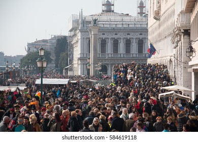 VENICE - February 19, 2017: Crowd on the promenade of Venice in time of annual festival Carnival (Carnevale)