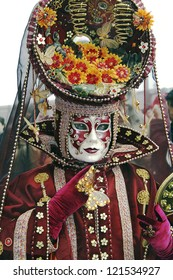 VENICE - FEBRUARY 19: Person in typical Venetian costume - mask - attends the Carnival of Venice. The Carnival on February 19, 2006 in Venice, Italy.