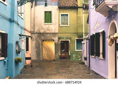 VENICE, FEBRUARY 2016: A typical multicoloured facade of buildings in Burano, Venice