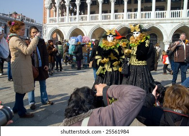 VENICE, FEBRUARY 21, 2009: Masks posing for photographers in front of the Palazzo Ducale at Riva degli Schiavoni during the Venice carnival 2009 which lasted from February 13 to 24, 2009.