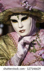 VENICE - FEBRUARY 3: People in Venetian costumes attends the Carnival of Venice, festival starting two weeks before Ash Wednesday .