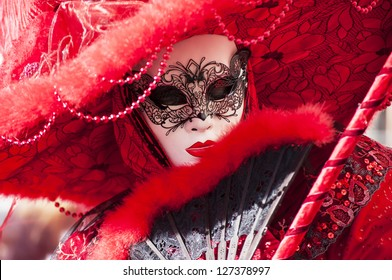 VENICE - FEBRUARY 3: People in Venetian costumes attends the Carnival of Venice, festival starting two weeks before Ash Wednesday in Venice, Italy,2013 feb 3