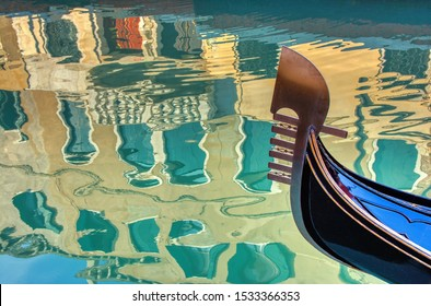 Venice gondola and reflection of buildings in water,Venice,Italy
