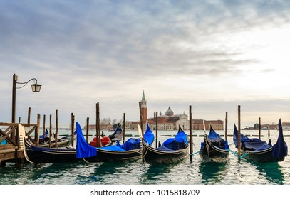 Venice gondolas moored by Saint Mark square during winter days