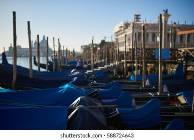 Venice gondolas parked at San Marc, at sunset
