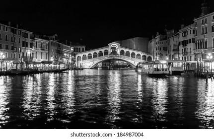 Venice Grand Canal near the Rialto bridge at night - Venice, Italy (black and white)