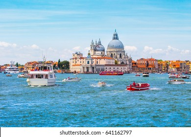 Venice - heavy boat traffic with Basilica di Santa Maria della Salute in the background