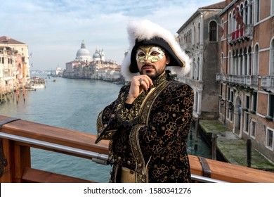 Venice, Itali: February 26, 2019 : Venice carnival 2019. Venetian Carnival Costume. Venetian Carnival Mask. Venice, Italy.