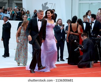 Venice, Italy. 02 September, 2017. George Clooney and Amal Clooney  walks the red carpet ahead of the 'Suburbicon' screening during the 74th Venice Film Festival