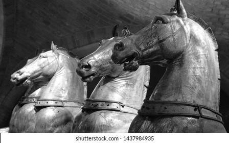 VENICE ITALY 05 13 19: Original of the Horses of Saint Mark as the Triumphal Quadriga, is a set of Roman bronze statues of 4 horses, originally part of a monument depicting a quadriga chariot racing